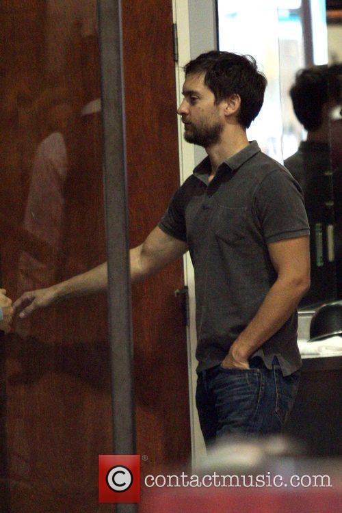 Tobey Maguire visits a barber shop in Beverly...