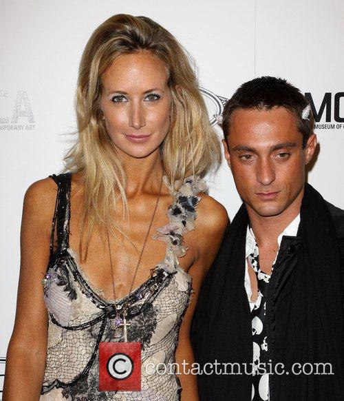 Lady Victoria Hervey and Guest Tod's Boutique grand...