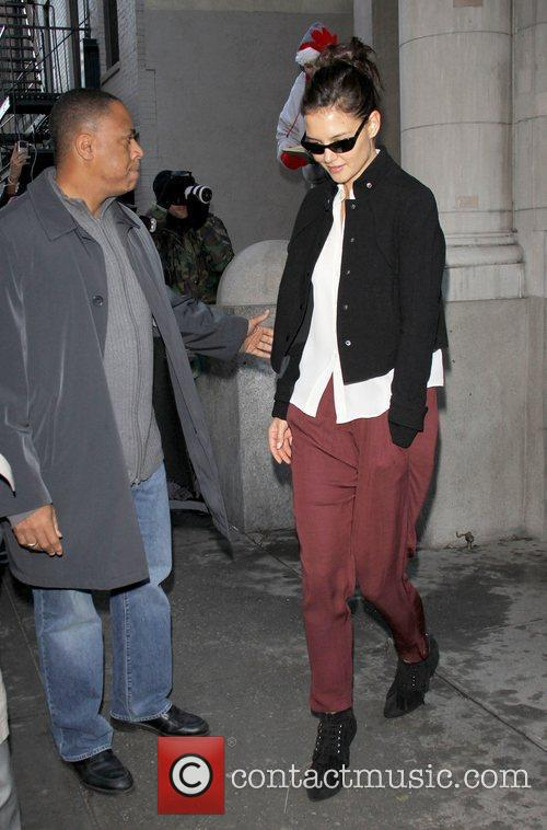 Katie Holmes, wearing dark sunglasses, whilst out on...