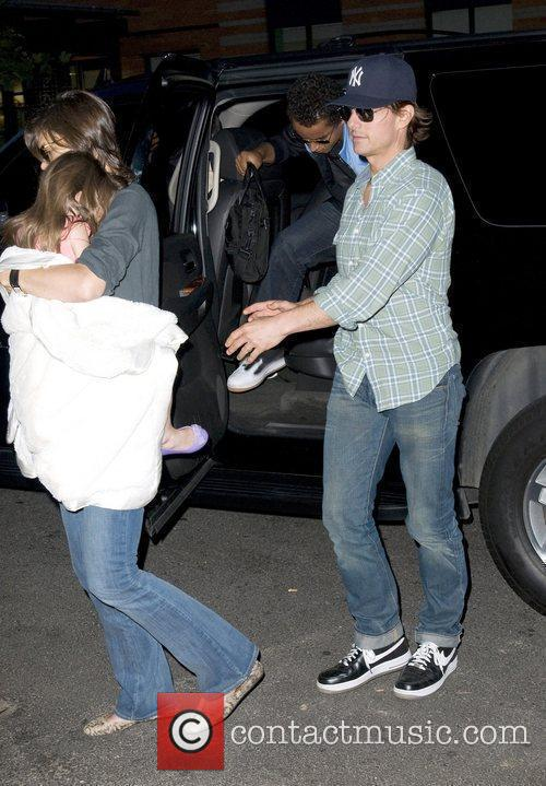 Tom Cruise and Katie Holmes  arrive back...