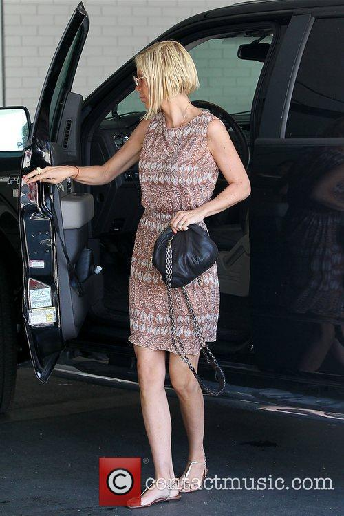 Tori Spelling arriving in a SUV at an...