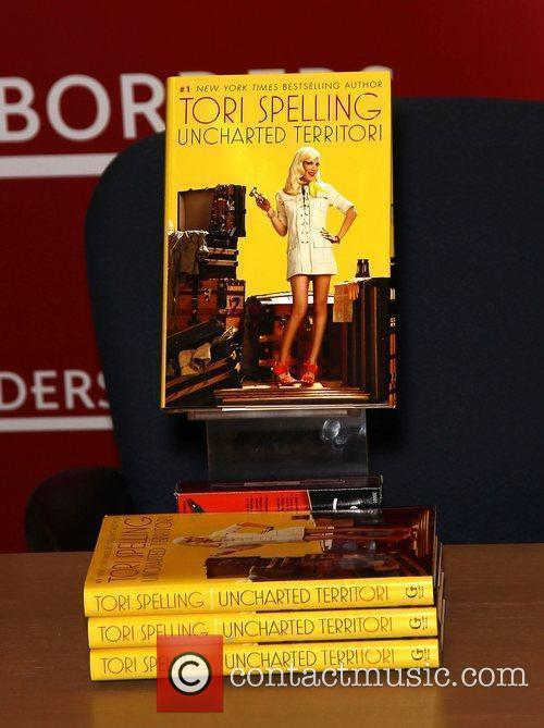 Tori Spelling signs copies of her book 'Uncharted...