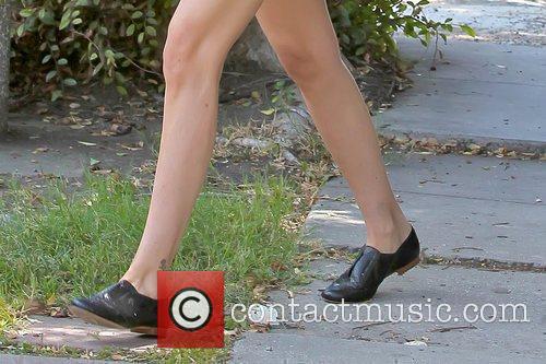 Tori Spelling's shoes Tori Spelling walking in Beverly...