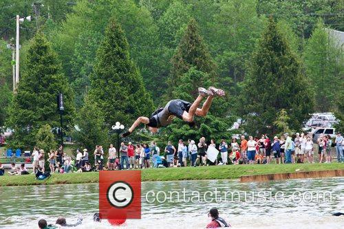 A Tough Mudder participant leaps into the water...