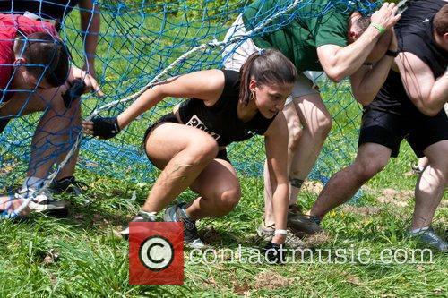Tough Mudder participants climb through the 'Devils Beard'...