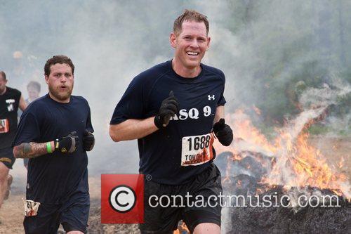 Tough Mudder participants running through the 'Fire Walker'...