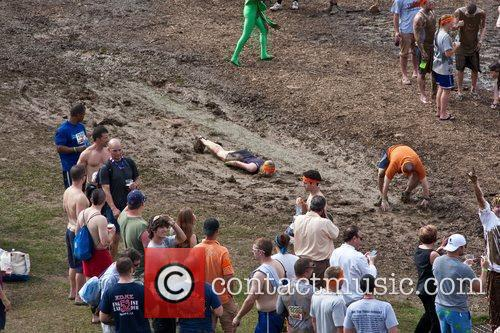 Tough Mudder Participants Slide In The Mud At The Post Race After Party. 4