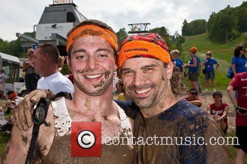 Two Tough Mudder Participants Smile After Crossing The Finish Line. 10
