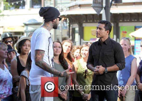 Mario Lopez interviews singer Travie McCoy  for...