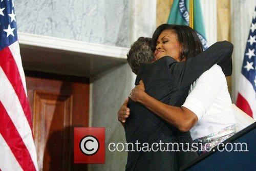 Secretary of Treasury Timothy Geithner and Michelle Obama...