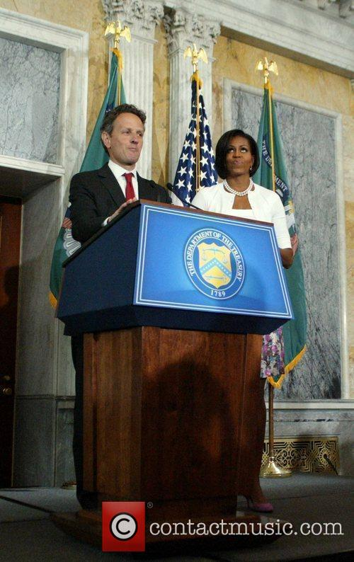 Michelle Obama and Timothy Geithner speaking to employees...