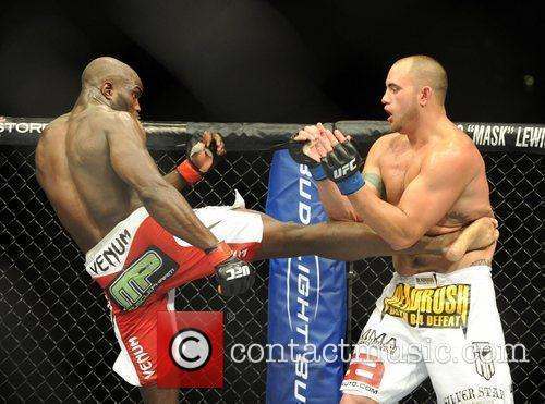Cheick Kongo of France in the red and...