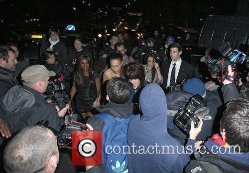 Tracey Cohan, Rebecca Ferguson and Cher Lloyd surrounded...
