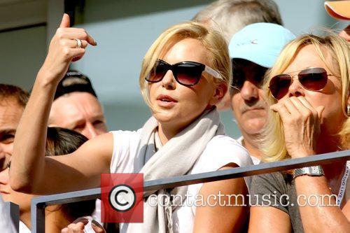 Celebrities arrive to watch the men's finals match...