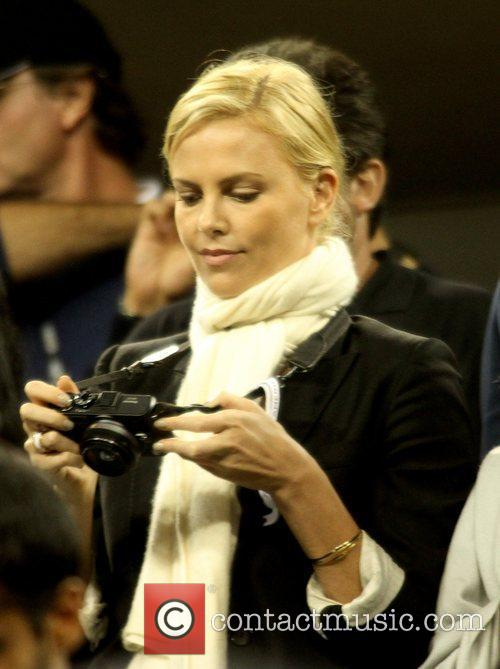 Charlize Theron Celebrities watch the men's finals match...