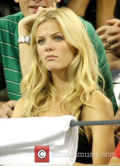 Watches her husband tennis player Andy Roddick play...
