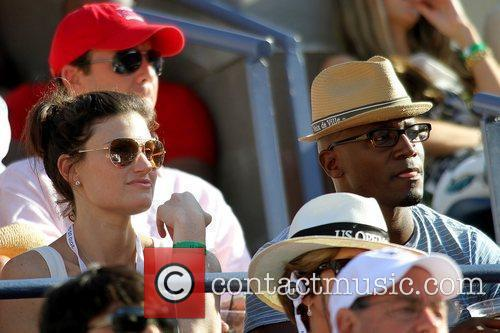 Taye Diggs and Idina Menzel Celebrities watching the...