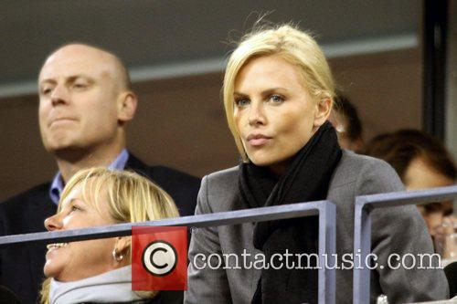 Charlize Theron Celebrities watching the women's semifinals match...