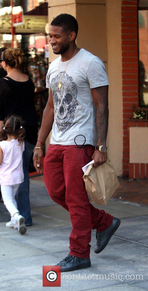 Usher is all smiles as he leaves a...