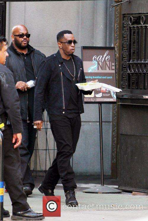 Sean Combs aka Diddy has some lunch on...