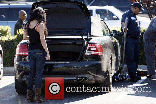 Vanessa Hudgens returns to her car after shopping,...