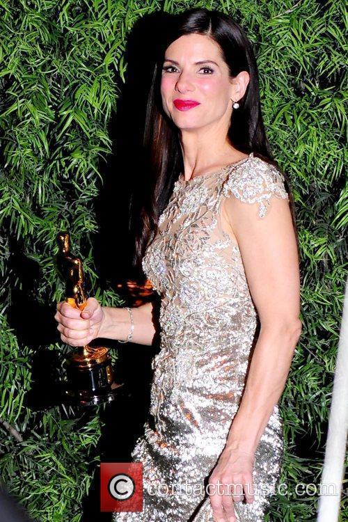 Sandra Bullock, holding her Academy Award for Best...
