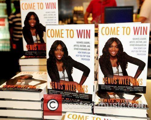 Atmosphere Venus Williams signs copies of her book...
