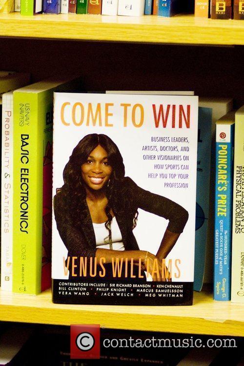 Venus Williams signs copies of her new book...
