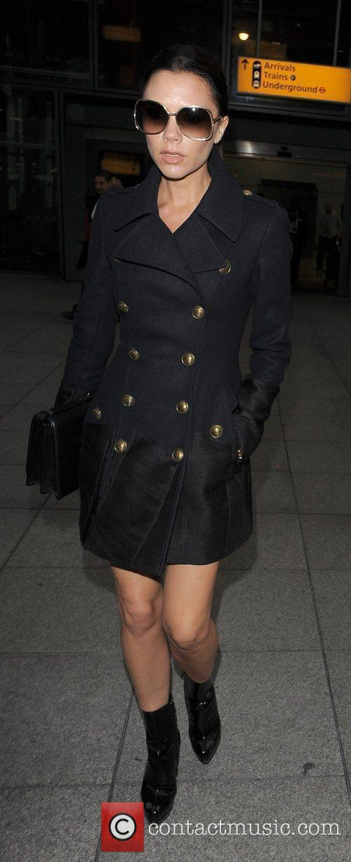 Victoria Beckham arriving into Heathrow Airport. Victoria tweeted...