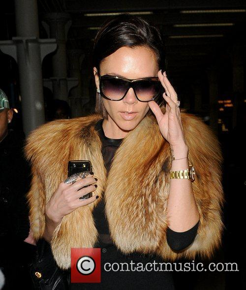 Victoria Beckham arriving in London while wearing a...