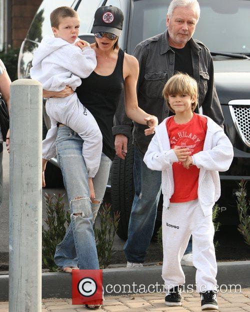 Victoria Beckham with her sons Cruz Beckham and...