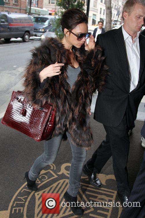 Victoria Beckham, Carrying A Rare Dark Red Crocodile Hermes Handbag and Arriving At Her Manhattan Hotel. 7