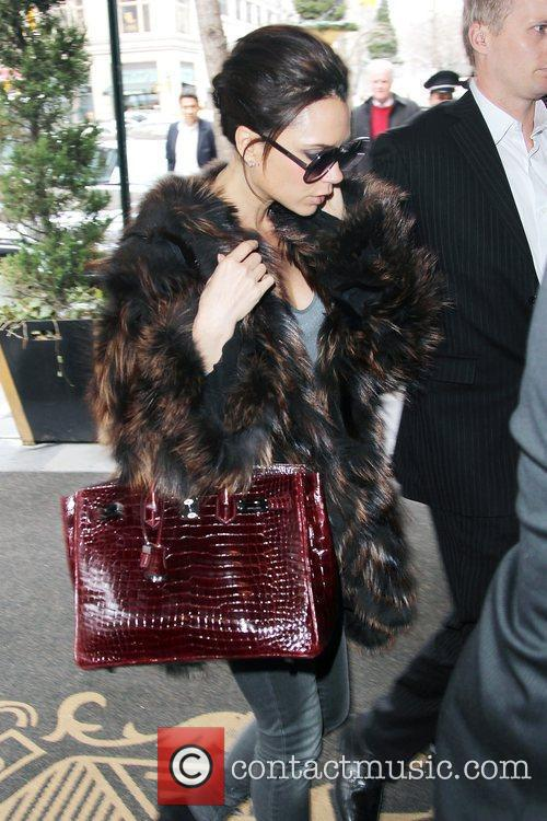 Victoria Beckham, Carrying A Rare Dark Red Crocodile Hermes Handbag and Arriving At Her Manhattan Hotel. 9