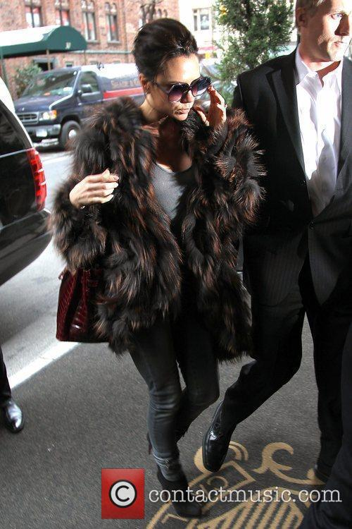 Victoria Beckham, Carrying A Rare Dark Red Crocodile Hermes Handbag and Arriving At Her Manhattan Hotel. 8