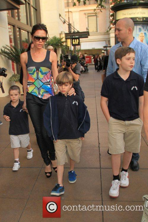 Victoria Beckham takes her sons Cruz, Romeo and...