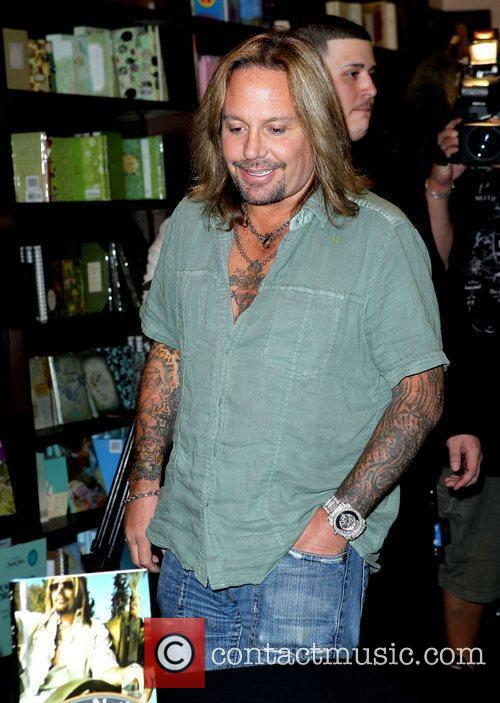 Signs copies of his new book 'Tattoos &...