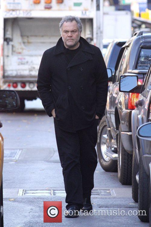 Vincent D'Onofrio walks onto the street to hail...