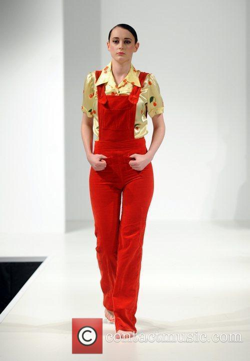 A model walks the catwalk in vintage clothing...
