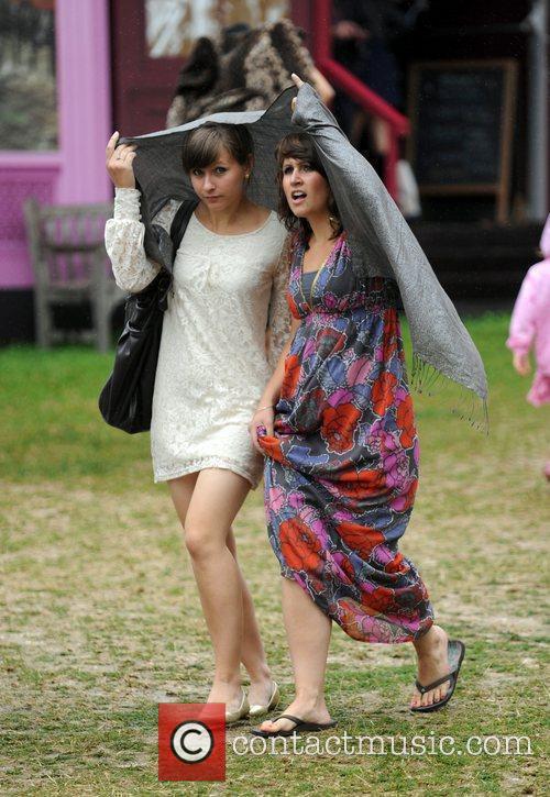 Festival goers at 'Vintage at Goodwood' summer festival....