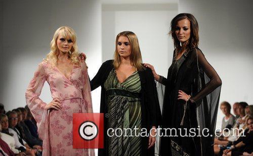 Models walk the catwalk in vintage clothing at...