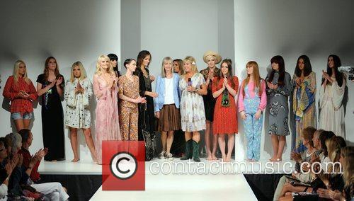 Pattie Boyd walks the catwalk in vintage clothing...