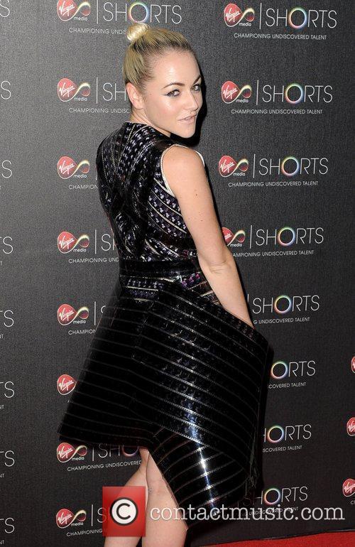 Jaime Winstone wears a dress made of film...