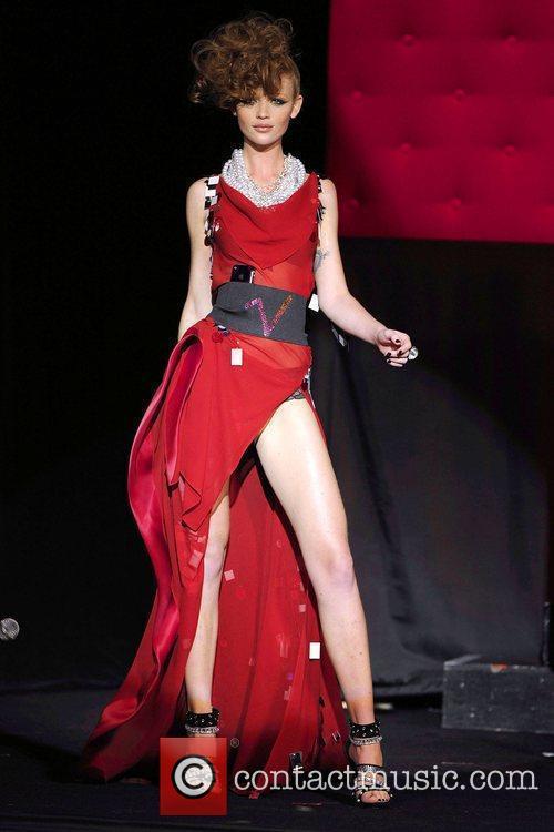 Cintia Dicker, Victoria Secret model, wearing an iPhone...