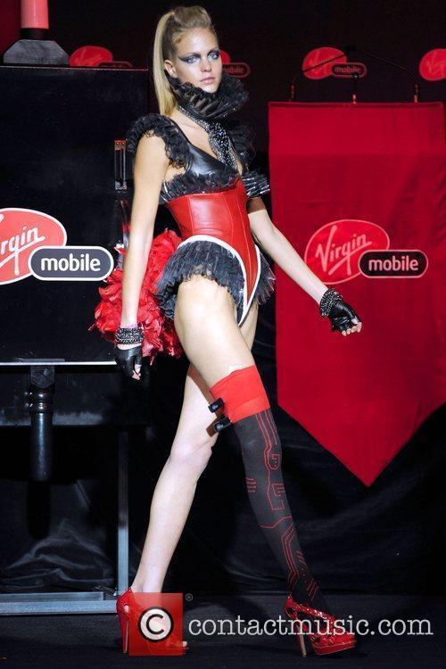 Erin Heatherton, Victoria Secret model, wearing a Mobile...