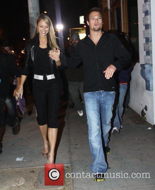Stacey Keibler and Geoff Stults outside Voyeur nightclub...