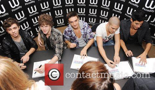 Sign copies of their first book, 'Our Story,...