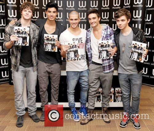 The Wanted sign copies of their first book,...