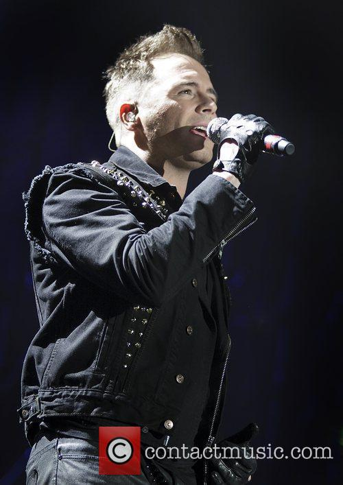 Westlife performing at Manchester Evening News Arena