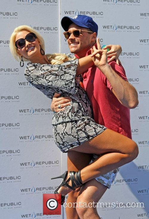 Holly Madison and Josh Strickland poses for a...