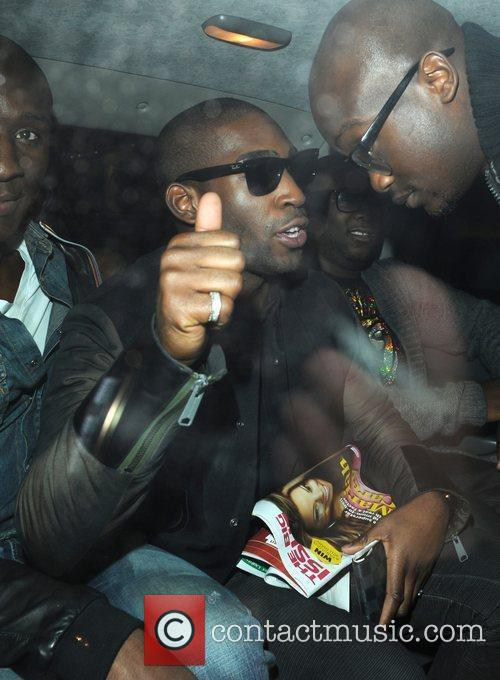 Tinie Tempah carries a Big Issue as he...